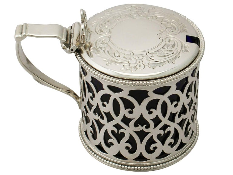 An exceptional, fine and impressive antique Victorian English sterling silver mustard pot; an addition to our silver cruets/condiments collection.  This exceptional antique Victorian sterling silver mustard pot has a plain cylindrical form.  The
