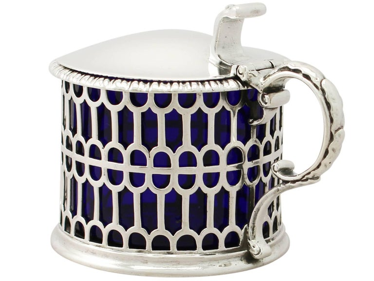 A fine and impressive antique Victorian English sterling silver mustard pot; an addition to our silver cruets/condiments collection.  This fine antique Victorian sterling silver mustard pot has a plain cylindrical form.  The body of the mustard