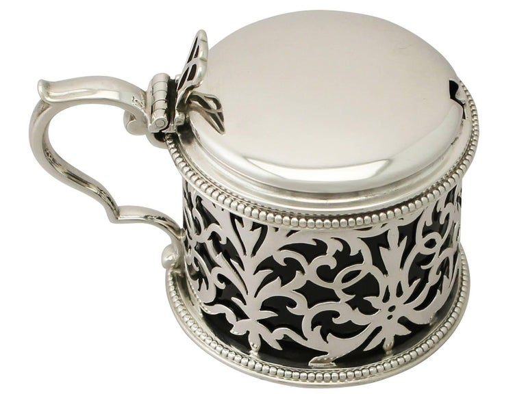 An exceptional, fine and impressive antique Victorian English sterling silver mustard pot made by Edward & John Barnard; an addition to our silver cruets/condiments collection.  This exceptional antique Victorian sterling silver mustard pot has a