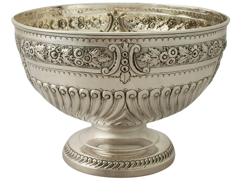 An exceptional, fine and impressive antique Victorian English sterling silver presentation bowl; an addition to our ornamental silverware collection