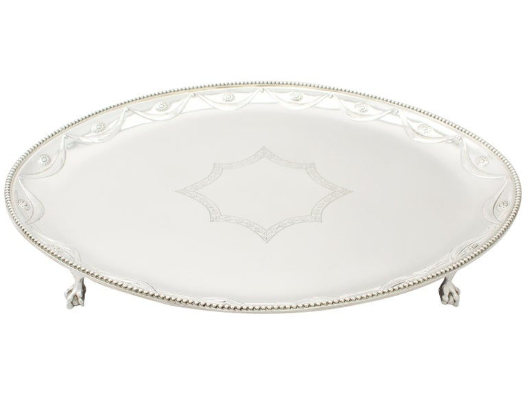 An exceptional, fine and impressive antique Victorian English sterling silver salver made by Walter & John Barnard; an addition to our ornamental silverware collection.