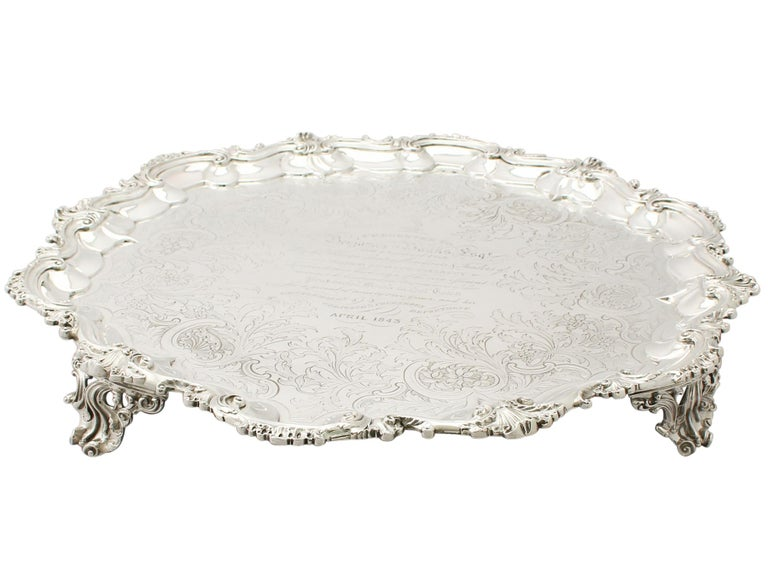 A magnificent, fine, large and impressive antique early Victorian English sterling silver salver by William Ker Reid; part of our antique salver collection.  This magnificent antique Victorian sterling silver salver has a circular shaped form onto