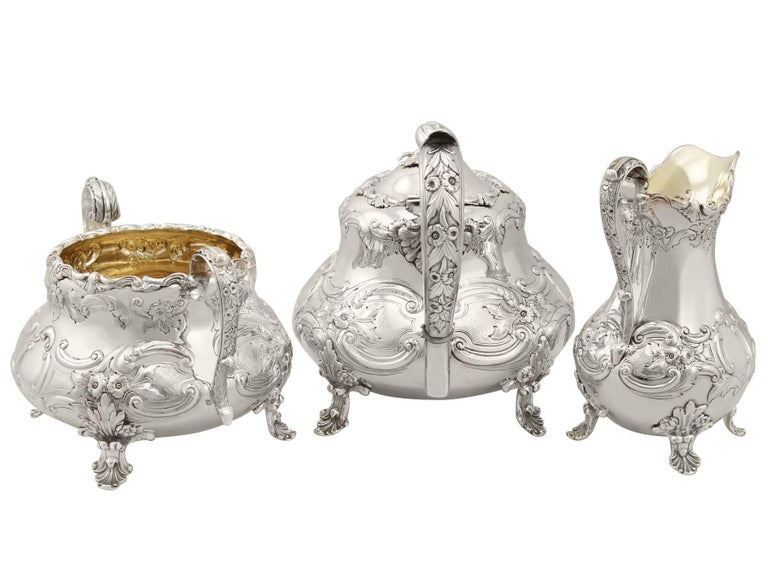 An exceptional, fine and impressive, antique Victorian English sterling silver three-piece tea service; part of our silver teaware collection.  This magnificent antique Victorian sterling silver three-piece tea set consists of a teapot, sugar bowl