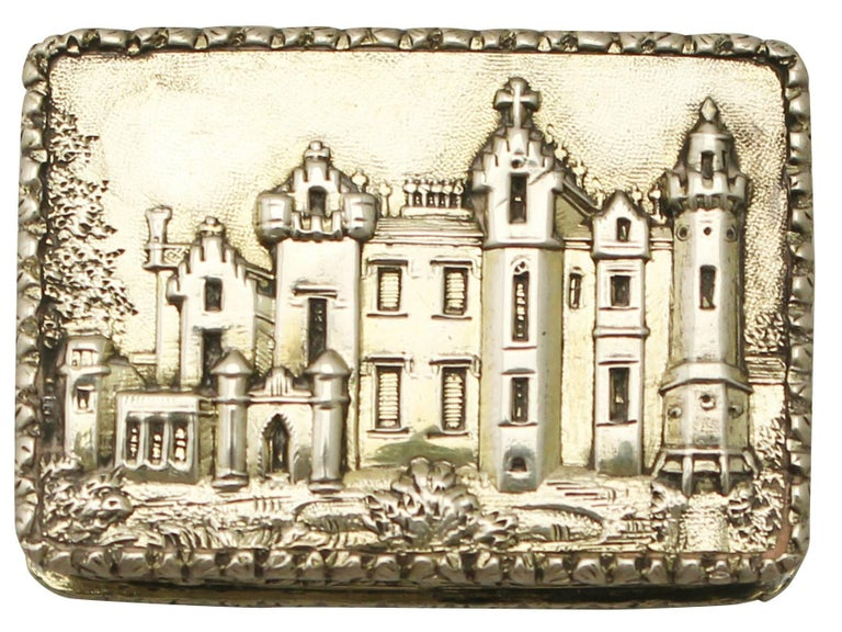 An exceptional, fine and impressive antique Victorian English sterling silver castle top vinaigrette depicting Abbotsford House; an addition to our collectable box collection.  This exceptional antique silver vinaigrette has a rectangular form