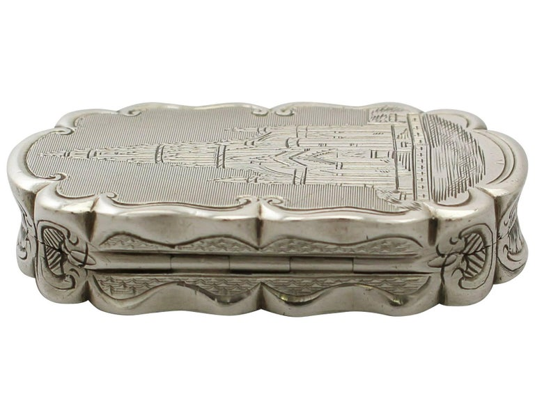 An exceptional, fine and impressive antique Victorian English sterling silver vinaigrette depicting Scott Monument; an addition to our boxes collection.  This exceptional antique Victorian sterling silver vinaigrette has a rectangular incurved
