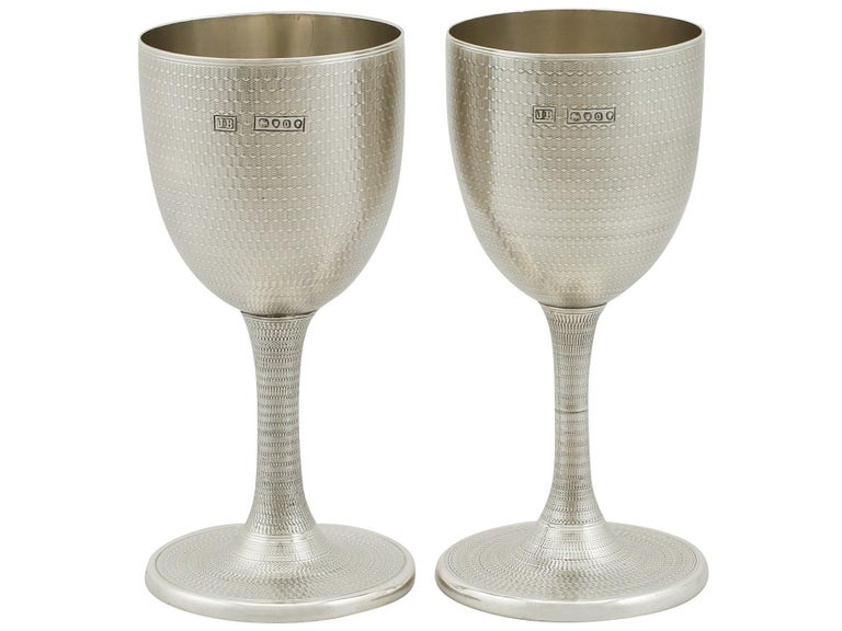 An exceptional, fine and impressive pair of antique Victorian English sterling silver wine goblets; an addition to our range of wine and drink related silverware.  These exceptional antique Victorian sterling silver wine goblets have a plain