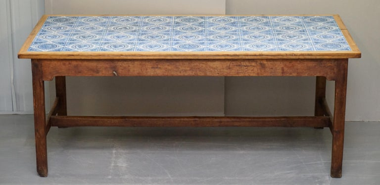 We are delighted to this lovely very decorative Victorian circa 1860 pine refectory dining table with tiled top  A good looking and well-made piece, highly decorative and looks English country house fine in any setting. The tiles are all correct