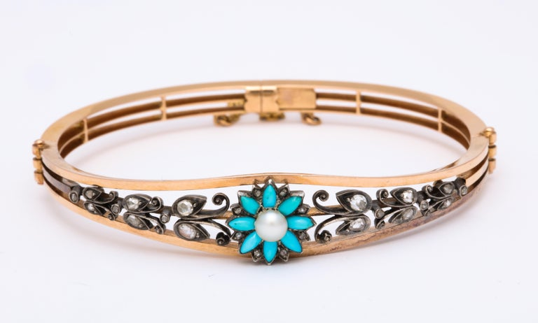 Reduced from $6300 to $5900, A fine, feminine, 18 kt bangle bracelet sets a Persian turquoise flower with a natural pearl directly center bringing you warm thoughts of summer all year. Rose diamond dew drops, approximately .25 cts,  rest on the