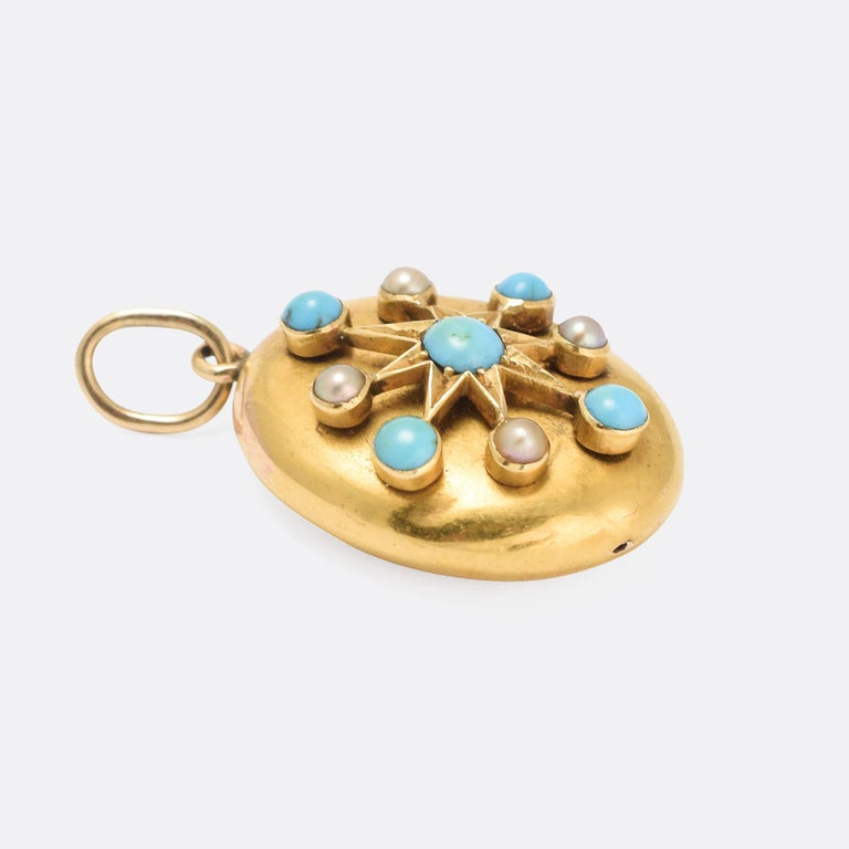A beautiful antique pendant dating from the late Victorian era. It's oval in shape, and set with turquoise cabochons and pearls arranged in a star motive. Modelled in 15 karat gold, it dates from the 1890s.  STONES  Turquoise and Pearl  MEASUREMENTS