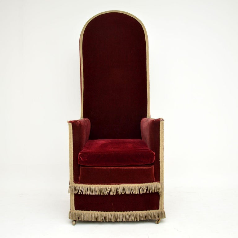 This antique Victorian high back armchair has a very high back, which is hard to visualize in the images, so double check the measurements. It has a very grand, almost throne like look & could have been used for something ceremonial.  This chair