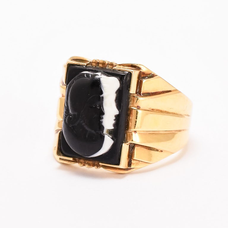 Love & War. A substantial antique signet ring set with an onyx cameo depicting Venus and Mars, both in profile facing to the right, the former rendered in white with Mars in black. The union between Mars and Venus was of particular importance to the