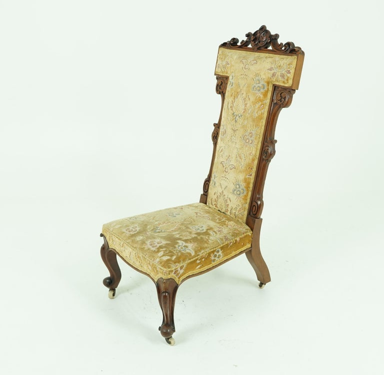 Antique Victorian carved walnut Prayer chair, Prie Dien chair, Scotland 1870, Antique Furniture 1638  Scotland 1870 Solid walnut Original finish Carved centre piece to the top High upholstered back Carved side supports Upholstered
