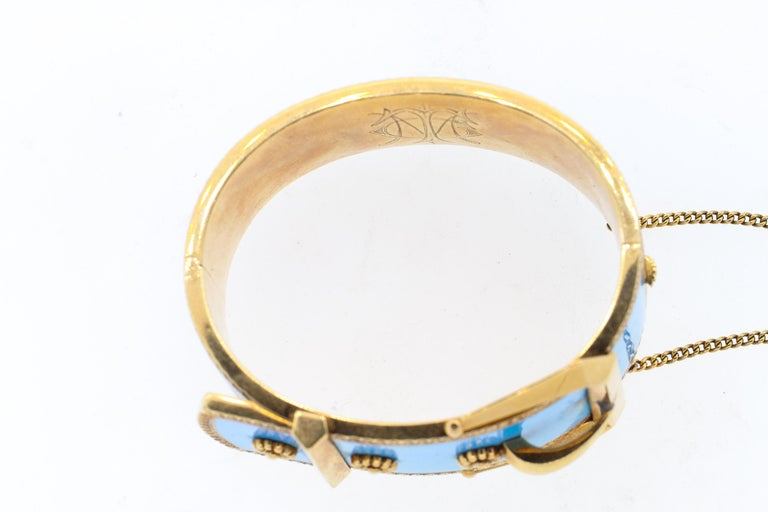 High Victorian wide robins egg blue enamel buckle bangle bracelet, circa 1880. This bracelet is in beautiful condition, with no chips to the vibrant turquoise blue enamel. The buckle motif is incredible modern in feel and this bracelet is very