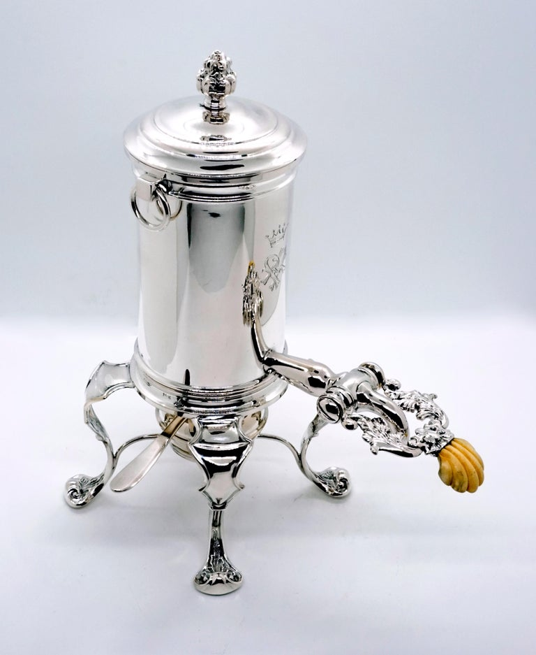 Consists of a hot water vessel with a lockable spout, two metal sieves, a silver warmer and a burner.