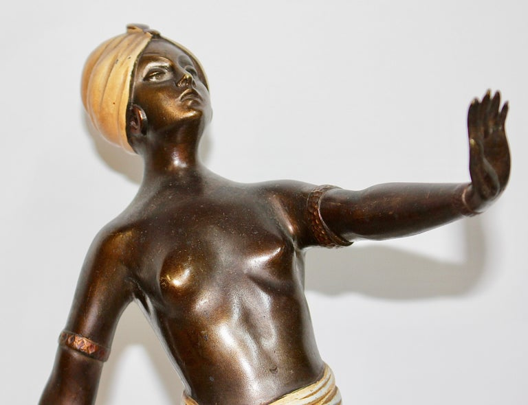 Antique Viennese bronze sculpture. Oriental nude dancer.  Enchanting and decorative antique bronze sculpture. Painted bronze on marble base. Very detailed quality and painting.