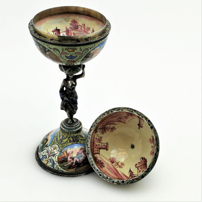 A gorgeous antique silver mounted Viennese enamel trinket box in the shape of a Renaissance style cup and cover.     Made in Vienna, Austria, circa 1880.   Measures: Approx. height - 21.2cm  Approx. diameter at rim - 7.6cm.    Signed/Inscribed: