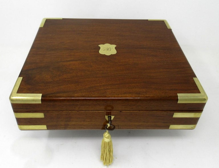 An exceptionally fine quality English well figured solid mahogany ladies or gents jewelry or storage box outstanding quality and medium proportions, with unusual moulded brass inlay decoration, flush hinges and polished brass shield form escutcheon,