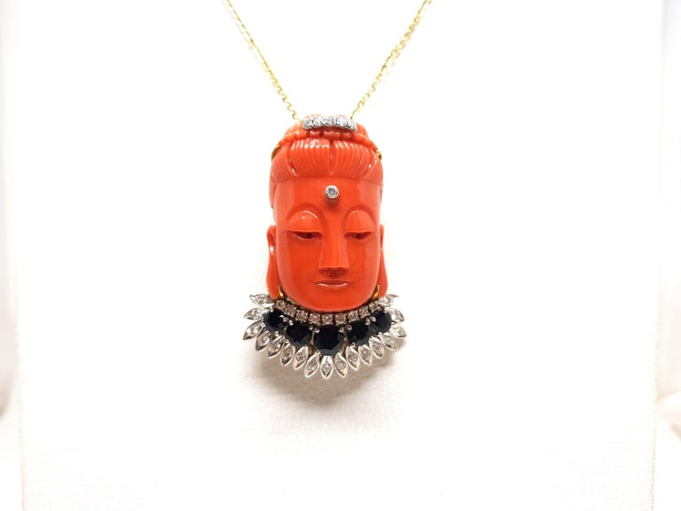 Can be worn as a Necklace with Pendant or Brooch Gold: 14K Yellow Gold.  Weight: 35.98 gr. Coral: 52.00ct. Diamonds: 0.93ct. G / VS2 Sapphires: 2.60ct. Gemstones are commonly enhanced for color or clarity Length: 5.2 cm Width: 3.4 cm  Length