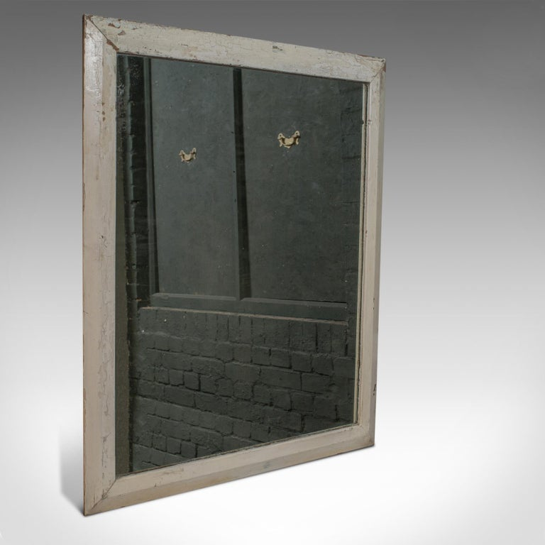 This is an antique wall mirror. An English, Victorian, pitch pine mirror dating to the late 19th century, circa 1880.  Substantial bevelled frame and reassuringly heavy Stout pitch pine frame benefits from good, consistent colour Grain interest