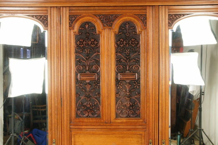 Antique walnut armoire, carved 3-door compaction closed wardrobe, Antique Furniture, Scotland 1880, B1719  Scotland 1880 Solid walnut Original finish Dentil cornice above Central door with carved panel Three raised panels below Door opens to