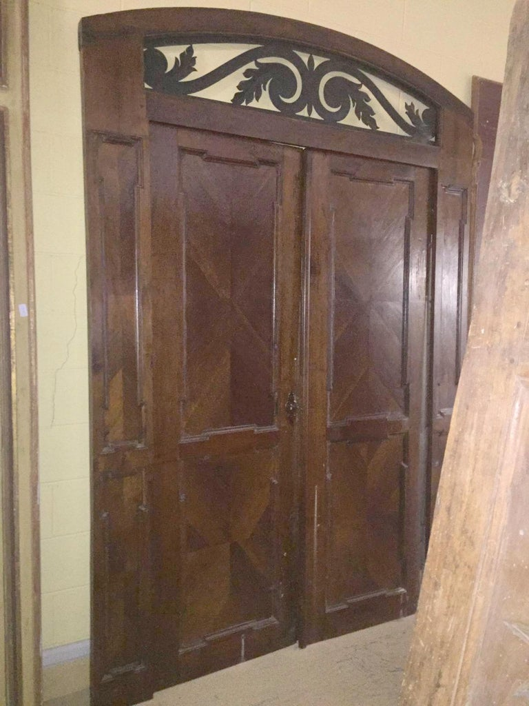 Hand-Carved Antique Walnut double Door , original frame and iron, '700 Italy For Sale
