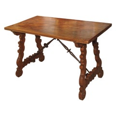 Antique Walnut Table from Spain with Iron Stretchers and Carved Feet, Late 1800s