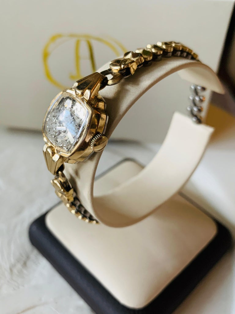 The Fairydust band is a non-functioning antique watch  a symbol, a talisman, to hold the intention of staying present, neither dwelling in the past nor looking toward the future. The fairydust inside are mirror shards, a shattering of the