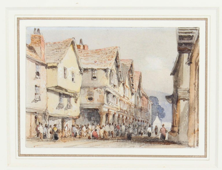Antique English watercolor York street scene by George Pyne (1800-1884) circa 1840 in date.  This wonderful watercolor features a scene with people going about their business in an old town street, painted with an excellent perspective in muted