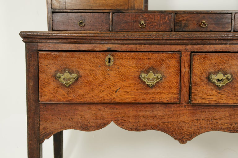 Antique Welsh dresser, oak cottage dresser. Farmhouse Furniture, England 1790, Antique Furniture, B1578.  England 1790 Solid oak construction with original finish Out turned cornice with scalloped frieze Graduating plate shelves with molded