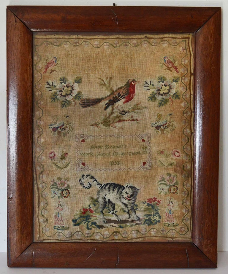 Lovely Welsh sampler with a cat and bird.  Pleasant text of Honour Thy Father And Thy Mother  By Anne Evans, 1853  Most unusual with having the wool work cat as a subject.  Original rosewood frame  The measurement given below is the frame