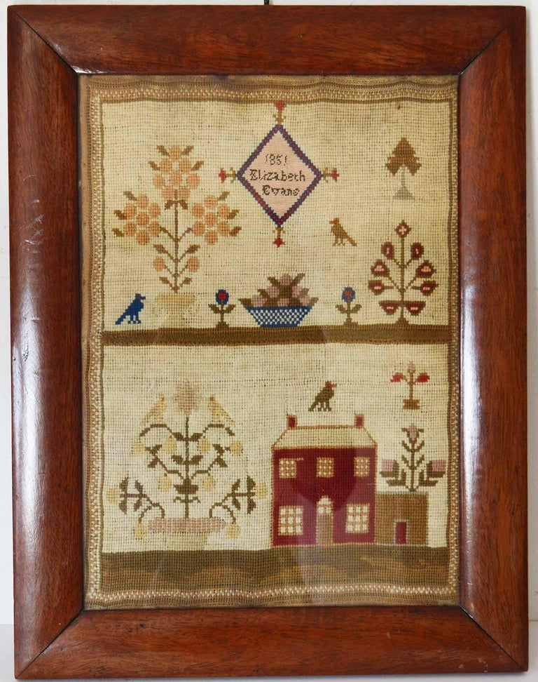 Lovely Welsh sampler with a country house.  By Elizabeth Evans, 1851  Most appealing with having the wool work of the country house as a subject.  Original rosewood frame  The measurement given below is the frame size.