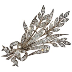 Antique White Gold Diamond Brooch as a Bouquet of Flowers with a Bow