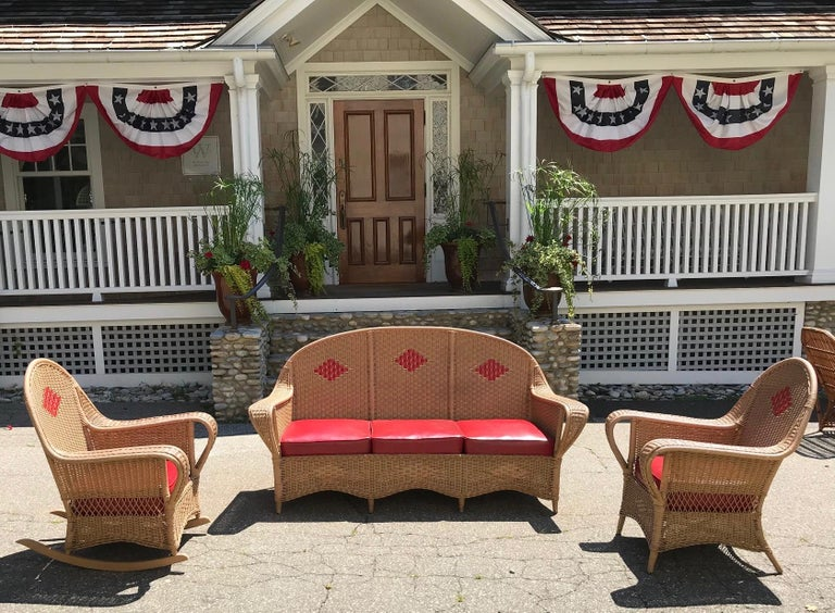 Antique deco four-piece wicker porch set consisting of sofa, chair, rocker and table. Box spring cushions covered in vinyl. Comfortable seating with vintage look. Custom painting available if different colors are preferred at additional cost. Sofa