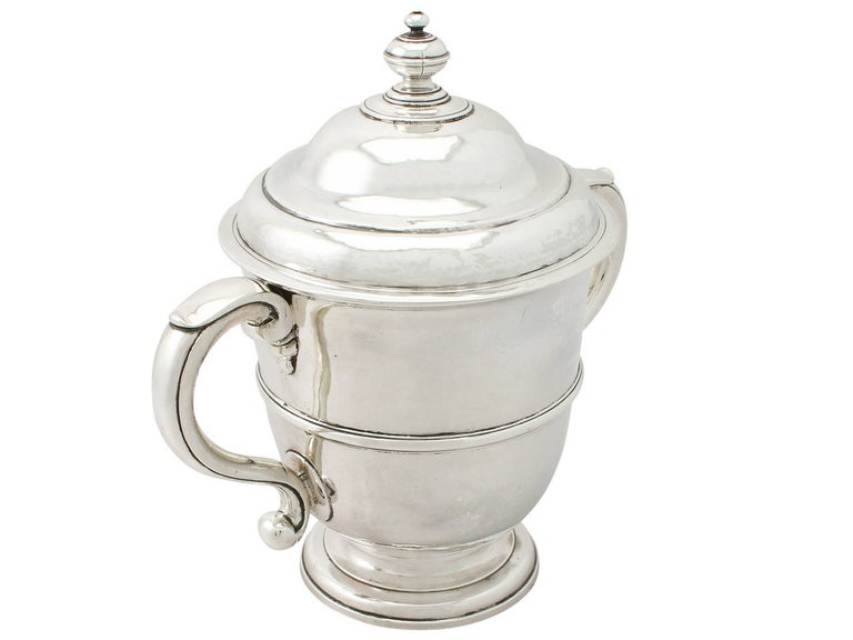 An exceptional, fine and impressive antique William III English Britannia standard silver cup and cover; an addition to our 17th century silverware collection  This fine antique William III Britannia standard silver cup and cover has a plain bell