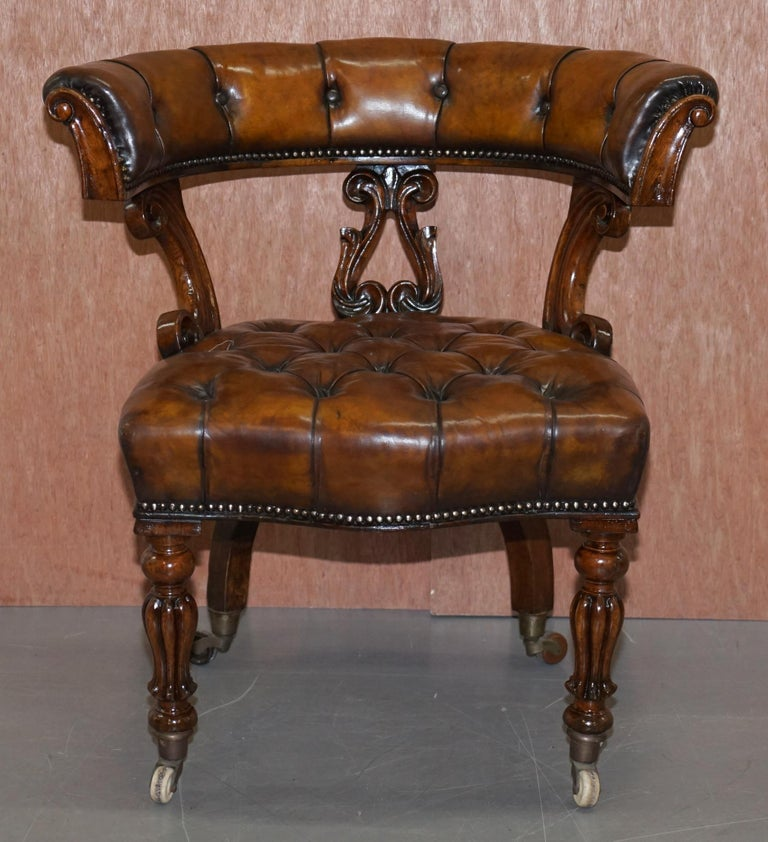 We are delighted to offer for sale this very fully restored circa 1830 horse shoe back Chesterfield hand dyed brown leather office chair  This chair is really quite exquisite, its one of the earliest types of swivel chairs ever made, the frame is