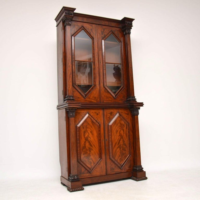 Very high quality and unusually designed antique William IV period mahogany two section bookcase. It's all original, from the 1830-1837 period and is in excellent condition. The front section is all flame mahogany, with diamond shaped bottom door