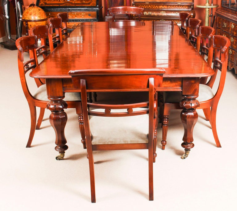 This is a gorgeous dining set comprising an antique William IV dining table circa 1830 in date with ten vintage bar back dining chairs.  The magnificent antique William IV solid mahogany dining table can seat ten people in comfort and is circa 1830