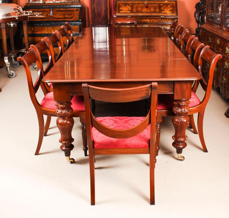 This is a fabulous dining set comprising of an antique William IV solid mahogany pullout dining table, circa 1835 in date, with a set of twelve vintage swag back dining chairs.  This beautiful table is in stunning flame mahogany, the pull out