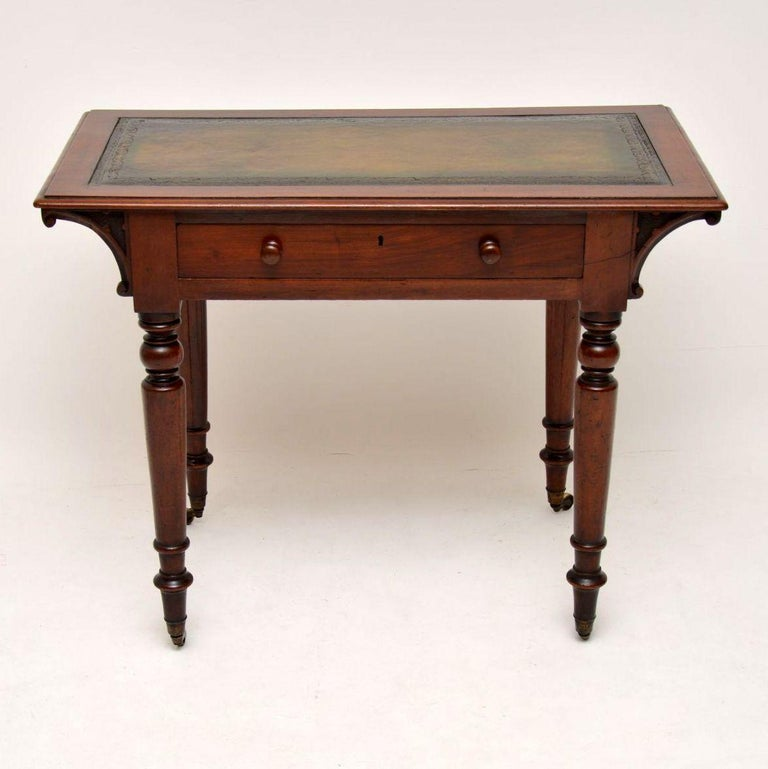 Antique William IV mahogany writing table in good original condition & with a lot of character. It has a tooled leather writings surface & a polished back. The single drawer has Fine dovetails, a lock & turned bun handles. It has interesting carved