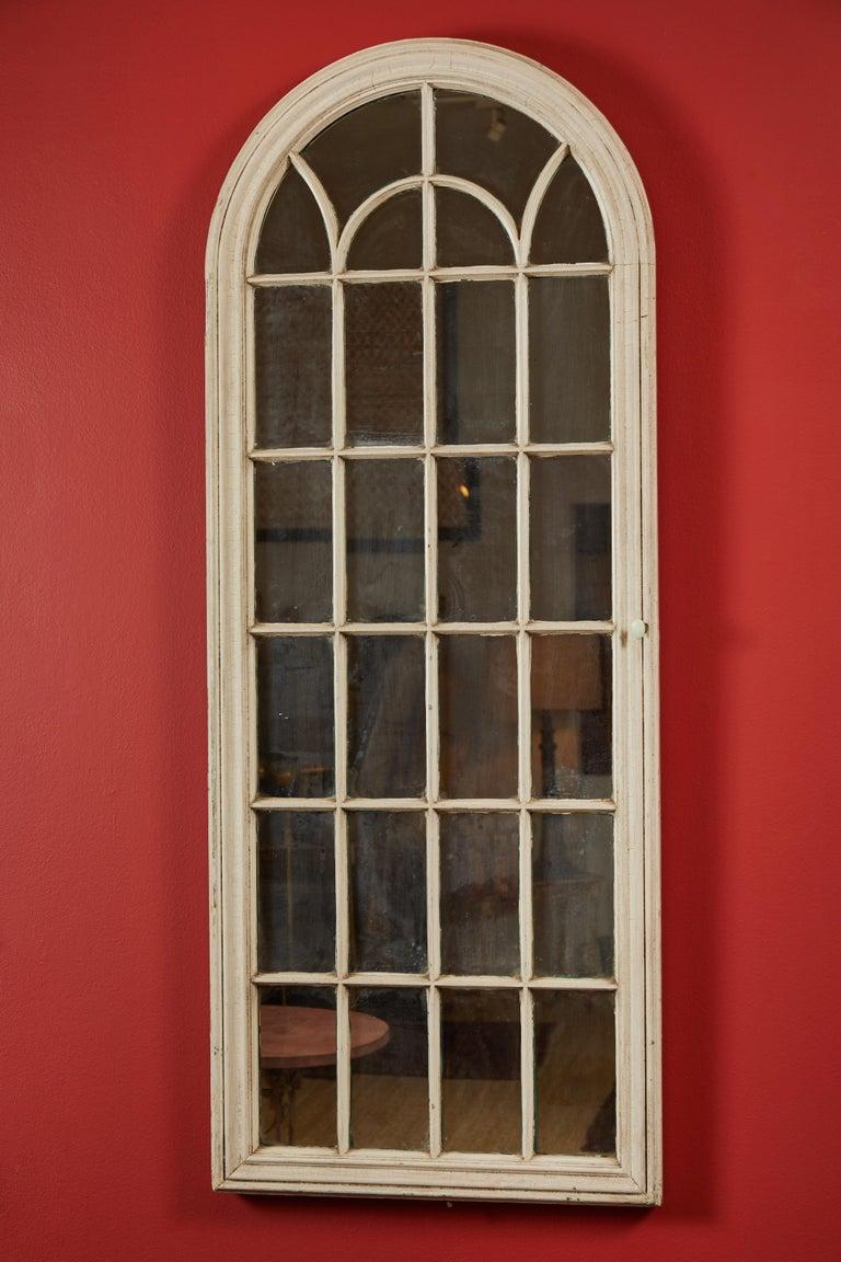 19th century Ecclesiastical cupboard doors on original mirror backs.