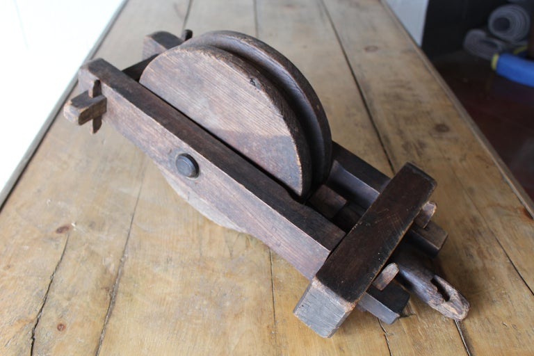 Antique English wood pulley.