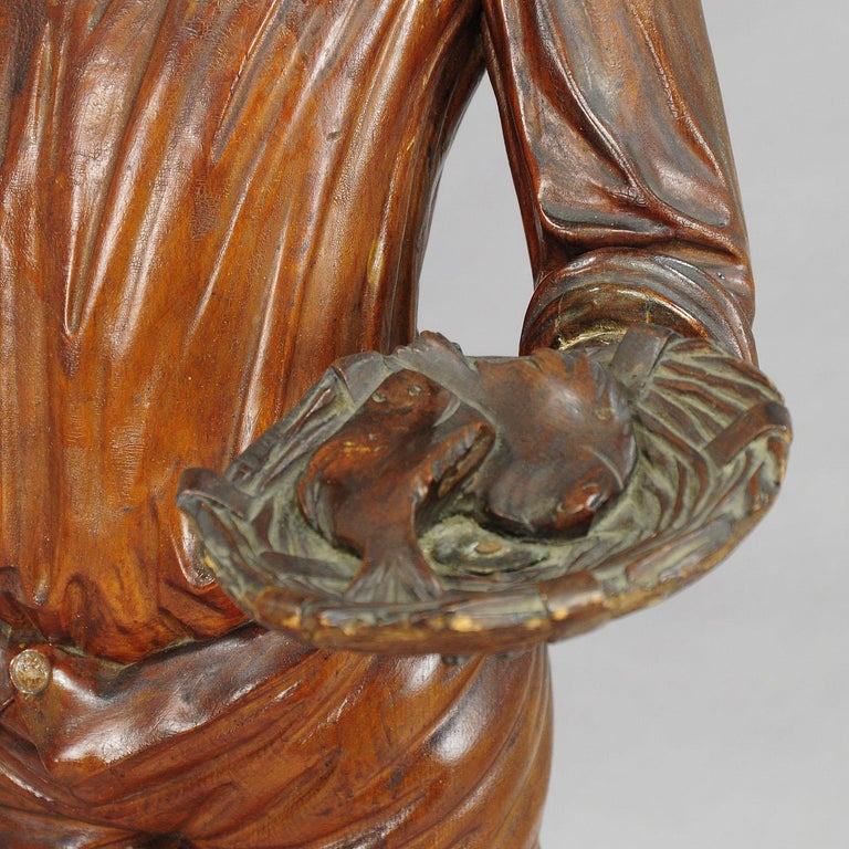 Swiss Antique Wooden Carved Statue of a Young Fisherman For Sale