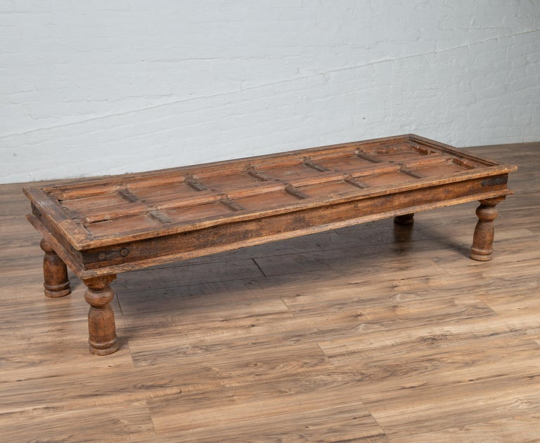 Antique Wooden Indian Palace Door Made into Coffee Table with Iron Braces For Sale 5