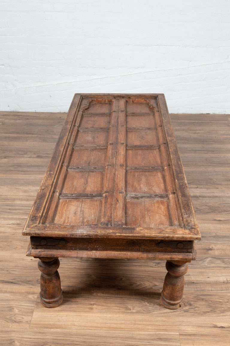 Antique Wooden Indian Palace Door Made into Coffee Table with Iron Braces For Sale 6