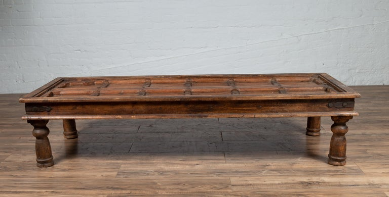 Antique Wooden Indian Palace Door Made into Coffee Table with Iron Braces For Sale 9