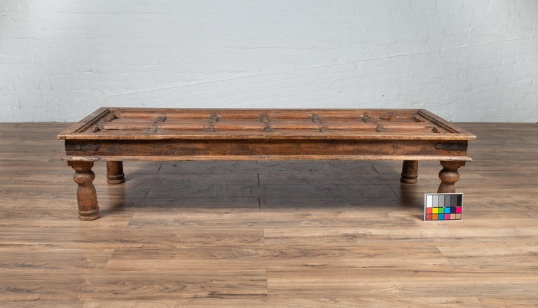 Antique Wooden Indian Palace Door Made into Coffee Table with Iron Braces For Sale 10