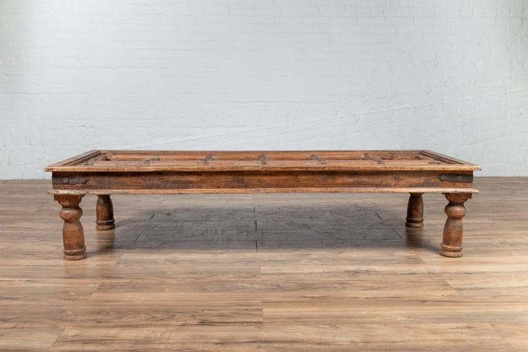 Rustic Antique Wooden Indian Palace Door Made into Coffee Table with Iron Braces For Sale