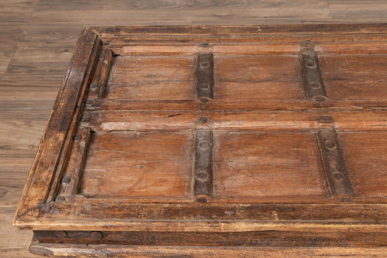 Antique Wooden Indian Palace Door Made into Coffee Table with Iron Braces In Good Condition For Sale In Yonkers, NY