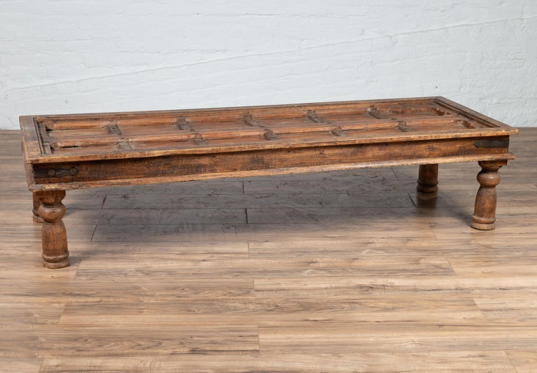 Antique Wooden Indian Palace Door Made into Coffee Table with Iron Braces For Sale 4