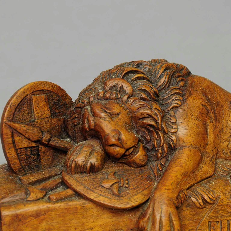 An old Swiss woodcarving of the famous lion of Lucern, Brienz, circa 1900.